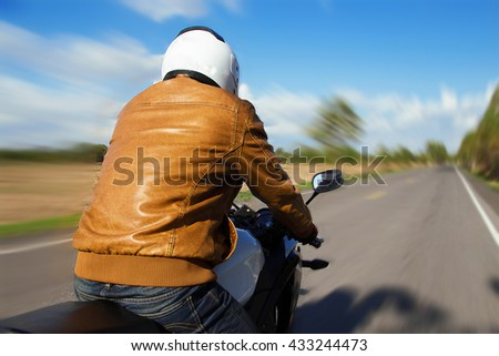 Moped drivers on road in summer sky bright - Travel by motorcycle Concept #433244473