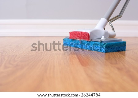 Mopping hardwood floor with a sponge mop