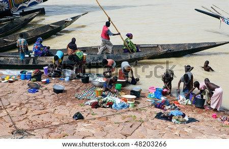 MOPTI - AUGUST 16: Women washing in the river, the lack of resources means that the population use the Niger river for washing and grooming, August 16, 2009 in Mopti, Mali