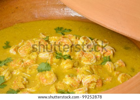 Moqueca de Camarao - Brazilian prawns in coconut milk and dende oil in a clay pan. Food from Bahia (Cozinha da Daiha) - stock photo