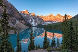Moraine Lake at sunrise, Famous place in Rocky Mountains, Canada.