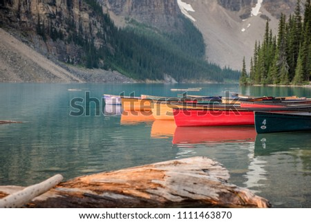 Moraine lake colorful canoes on water