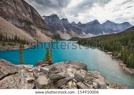Moraine lake in the rocky mountains on a cloudy day