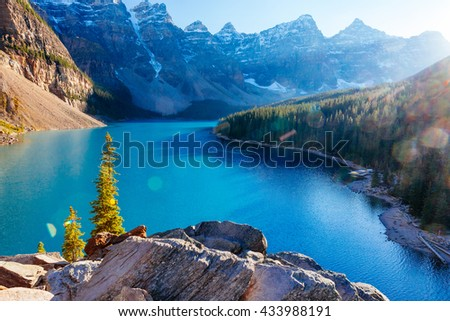 Moraine Lake is a glacially-fed lake in Banff National Park 14 km outside of Lake Louise, Alberta, Canada. It is situated in the Valley of the Ten Peaks, at an elevation of approximately 1885 m. - Shutterstock ID 433988191