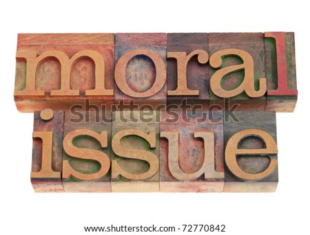 moral issue phrase in vintage wood letterpress printing blocks, isolated on white