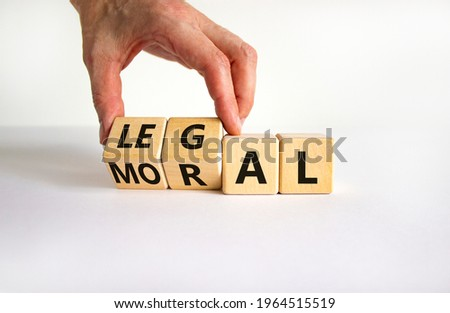 Moral or legal symbol. Businessman turns wooden cubes and changes the word 'moral' to 'legal' on a beautiful white table, white background. Business and moral or legal concept. Copy space. Foto d'archivio ©