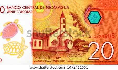 Moravian church at Pearl Lagoon. Turtles as see-through feature. portrait from Nicaragua 20 Cordobas 2014 Banknotes. Nicaraguan money Closeup Collection. #1492461551