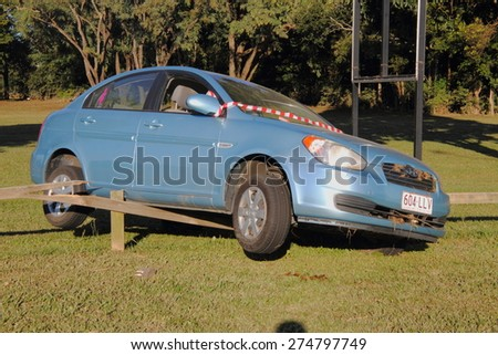 MORAYFIELD, AUSTRALIA - MAY 2: Car that was washed away during flash flood and left dry on fence, flood killed five in cars on May 2, 2015 in Morayfield, Australia