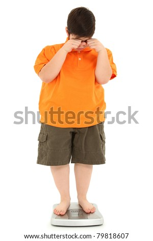 Morbidly obese fat child on scale crying Weight loss Concept.