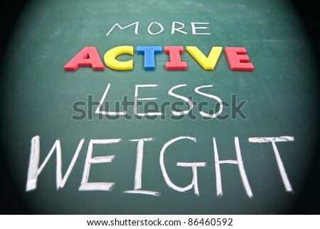 More active less weight, healthy concept on blackboard.