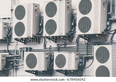 More Air conditioning system (Coil air heater) assembled on side of a building.Thailand #678406042