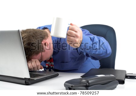More Coffee - businessman pleads for more coffee while laying his head on his keyboard