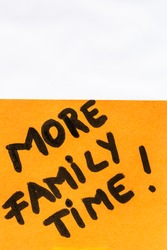More family time handwriting text close up isolated on orange paper with copy space.