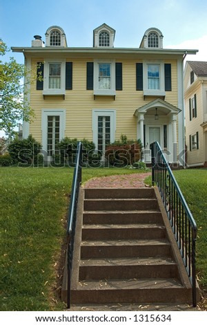 More of a mix of Federal and Colonial architecture  home. Nice inviting stairway leads you to the porch. This house is located in the historic Lancaster Ohio.