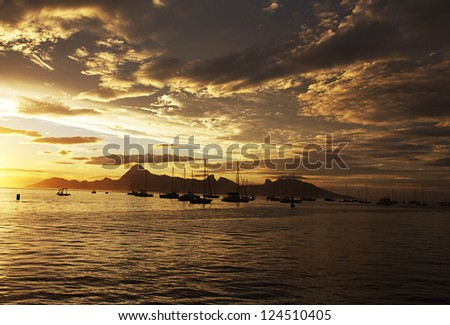 Morea island view from the sea at sunset - French Polinesia
