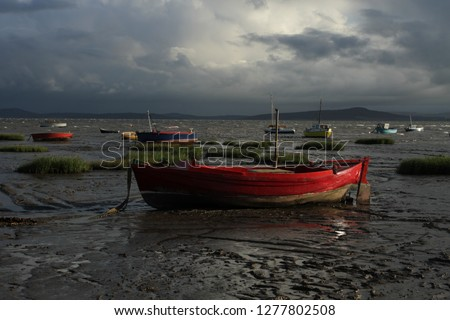 Morecambe bay fishing boat, red boat Lake District