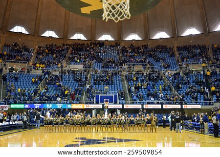 MORGANTOWN, WV - MARCH 7: The WVU dance team lines up on the court following the Big 12 Conference college basketball game March 7, 2015 in Morgantown, WV.