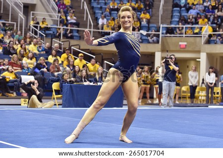 MORGANTOWN, WV - MARCH 8: WVU gymnast Mackenzie Myers   competes on the floor exercise during a dual meet March 8, 2015 in Morgantown, WV.