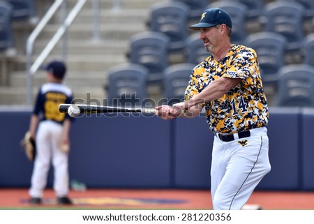 MORGANTOWN, WV - MAY 2: WVU baseball head coach Randy Mazey hits grounders during pre game drills prior to a Big 12 conference baseball game May 2, 2015 in Morgantown, WV.