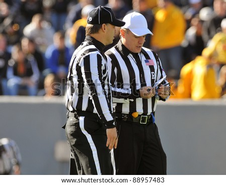 MORGANTOWN, WV - NOVEMBER 5: Game officials meet just prior to kickoff of the game between Louisville and WVU on November 5, 2011 in Morgantown, WV.