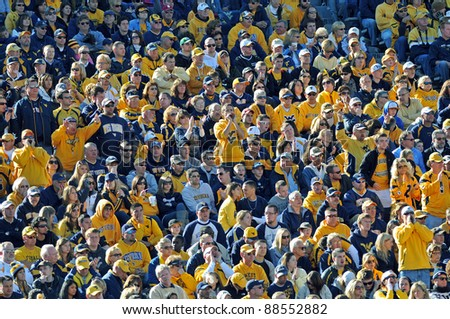 MORGANTOWN, WV - NOVEMBER 5: West Virginia University Mountaineer football fans look on from the crowded stands during the football game between Louisville and WVU November 5, 2011 in Morgantown, WV.