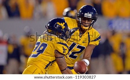 MORGANTOWN, WV - NOVEMBER 17: WVU quarterback Geno Smith (12) hands the ball off during the Big 12 conference game between the Mountaineers and Sooners November 17, 2012 in Morgantown, WV
