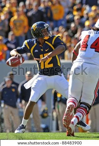 MORGANTOWN, WV - NOVEMBER 5: WVU quarterback Geno Smith (#12) winds to throw a long pass during the football game between WVU and Louisville November 5, 2011 in Morgantown, WV