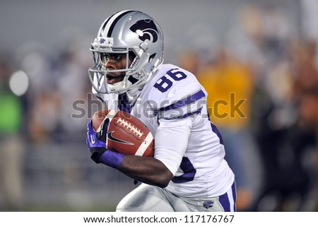 MORGANTOWN, WV - OCTOBER 20:  Kansas State Wildcats receiver Tremaine Thompson takes the opening kickoff of the Big 12 football game October 20, 2012 in Morgantown, WV.