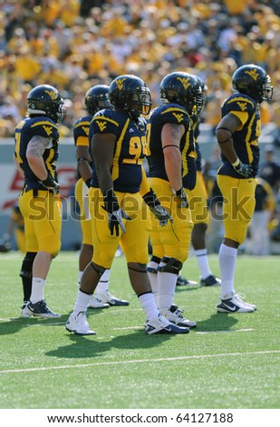 MORGANTOWN, WV - OCTOBER 23: Members of the West Virginia University defense wait for the offense to come to the line October 23, 2010 in Morgantown, WV.