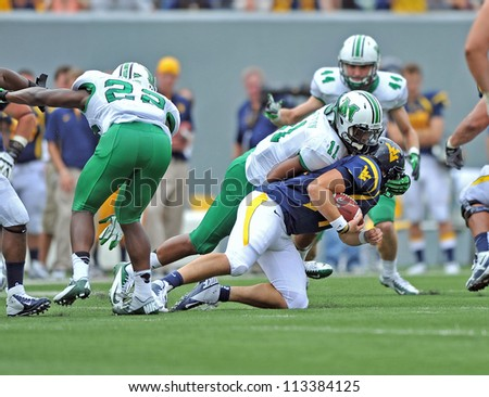 MORGANTOWN, WV - SEPTEMBER 1: Marshall linebacker Devin Arrington (#11) sacks the WVU quarterback late in the first football game of the season against WVU September 1, 2012 in Morgantown, WV.