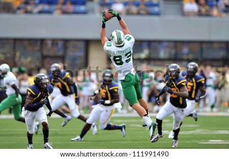 MORGANTOWN, WV - SEPTEMBER 1: Marshall tight end Eric Frohnapfel (#83) goes up to catch a pass during the first football game of the season against WVU September 1, 2012 in Morgantown, WV.