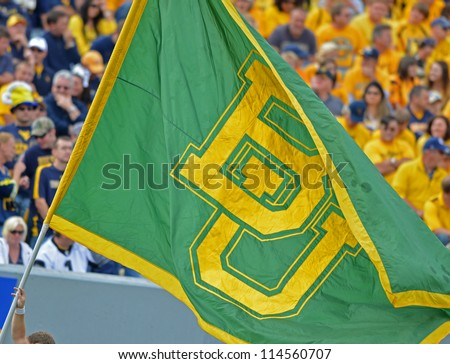 MORGANTOWN, WV - SEPTEMBER 29: The Baylor University flag is carried on the field after a Bears touchdown during a Big 12 conference football game September 29, 2012 in Morgantown, WV.