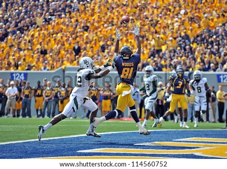 MORGANTOWN, WV - SEPTEMBER 29: West Virginia Mountaineers wide receiver J.D. Woods (81) goes up to make a touchdown catch during a Big 12 conference football game September 29, 2012 in Morgantown, WV.