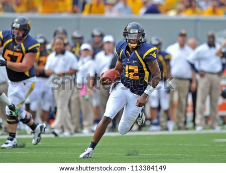 MORGANTOWN, WV - SEPTEMBER 1: WVU quarterback Geno Smith (#12) cuts back en route to a late touchdown run during the first football game of the season against WVU September 1, 2012 in Morgantown, WV.