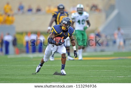 MORGANTOWN, WV - SEPTEMBER 1: WVU receiver Tavon Austin runs with the ball in the open field for a long gain during the first football game of the season September 1, 2012 in Morgantown, WV.