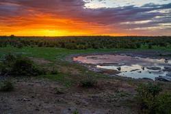 Moringa waterhole Halali camp in Etosha national park at sunset in Namibia