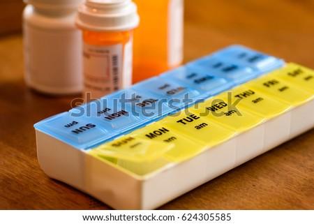 Morning and evening pill holder closeup #624305585
