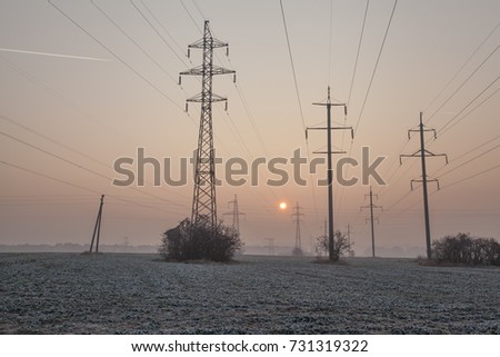 morning autumn landscape with pillars of electric lines  #731319322