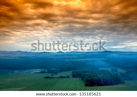 morning awakening landscape with hills and mist