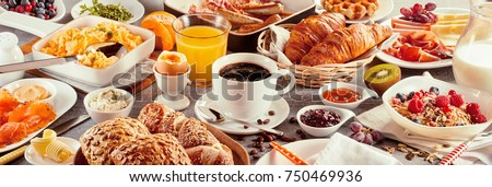 Morning breakfast banner with a coffee cup served surrounded by various nutritious food as delicious French croissants, cereals, and fruits #750469936