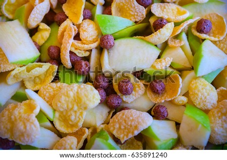 Morning breakfast. Cereal flakes. Cornflakes. Apples are cut into pieces.