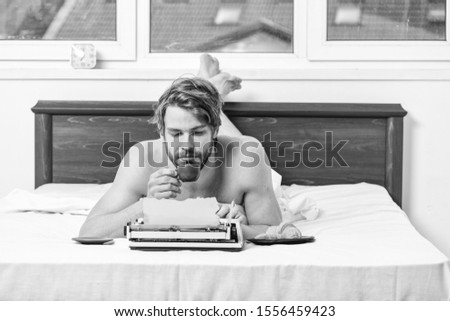 Morning bring fresh idea. Morning inspiration. Erotic literature. Daily routine of writer. Man writer lay bed with breakfast working. Writer handsome author used old fashioned manual typewriter.