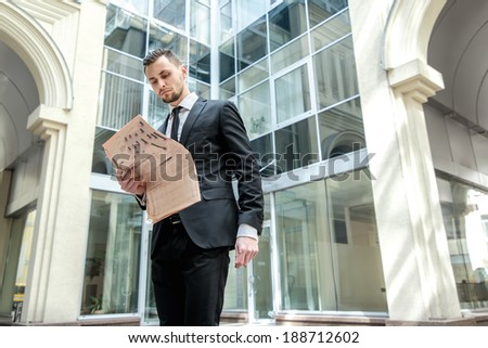 Morning business news. Business man formal wear standing in downtown reading a newspaper