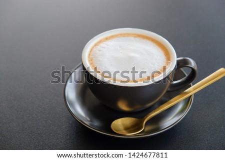 Morning cappuccino coffee on dark table