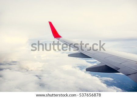 Morning cloudy sunrise with Wing of an airplane. picture for add text message or frame website. Traveling concept #537656878