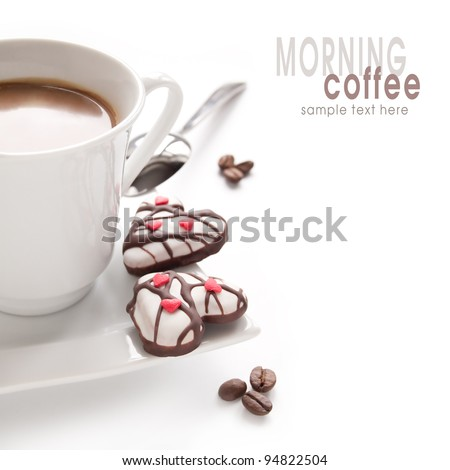 Morning coffee and biscuits in the shape of hearts on the white background