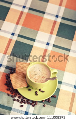 morning coffee latte with beans and biscuits