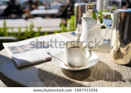 Photo of Morning Coffee On Cafe Table In The Sun