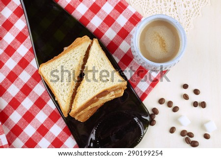 Morning Coffee. Toasts with bacon and cheese. Food and Drink. Coffee and lunch time. The atmosphere of inspiration and recreation. Stay for a Cup of coffee. Table of food. Still life food.