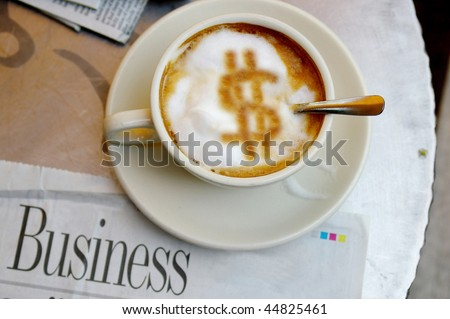 morning coffee with dollar sign and paper - stock photo